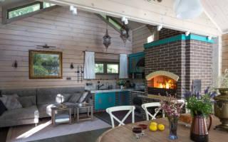 Интерьер кухни гостиной в загородном доме